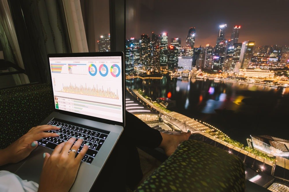 freelancer working on laptop with cityscape